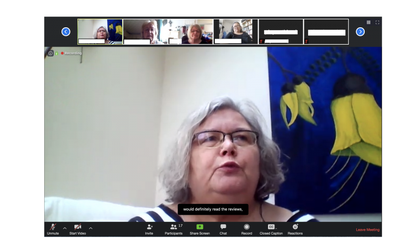 "A screenshot of a focus group on Zoom with a lady with grey hair and glasses talking midscreen. 4 others are visible in the gallery view of attendees above. There is captioning of her conversation which reads ...""would definitely read the reviews"""