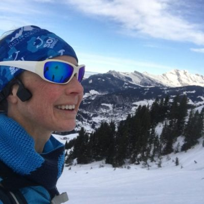 Skier wearing Shockz headphones