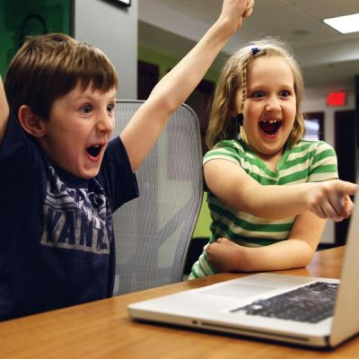 Kids excited using laptop