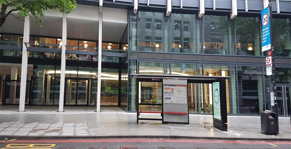 Exterior view of the WeWork building at 30 Stamford Street. Also shows the bus stop outside the building.
